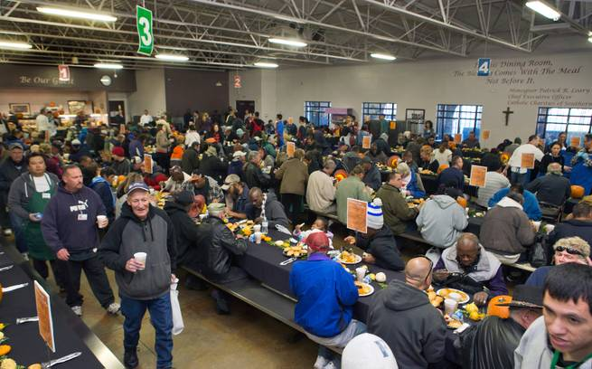 The dining room is filling up as Catholic Charities of Southern Nevada serves a traditional Thanksgiving dinner to homeless and vulnerable men, women and children on Thanksgiving Day on Thursday, November 26, 2015.