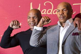 "Former heavyweight boxing champion Mike Tyson, left, stands with the world's first Mike Tyson wax figure during the figure's unveiling Tuesday, Dec. 1, 2015, at Madame Tussauds Las Vegas. The figure is modeled after Tyson's appearance as himself in ""The Hangover."" The figure will be permanently displayed inside the attraction's ""The Hangover Experience"" exhibit."