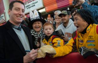 Kyle Busch greets fans during 2015 NASCAR Sprint Cup Series Weekend fan fest Wednesday, Dec. 2, 2015, at Fremont Street Experience in downtown Las Vegas.