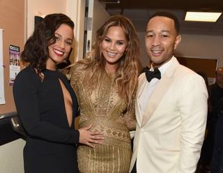 "Alicia Keys, a pregnant Chrissy Teigen and John Legend attend the ""Sinatra 100"" tribute and Grammy concert at Encore Theater on Wednesday, Dec. 2, 2015, at Wynn Las Vegas."
