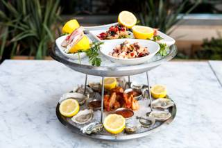 The seafood tower from the Salt & Brine Bar at Herringbone in Aria by chef Brian Malarkey.
