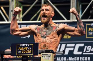 UFC featherweight interim titleholder Conor McGregor flexes and yells during UFC 194 weigh-ins Friday, Dec. 11, 2015, at MGM Grand Garden Arena.