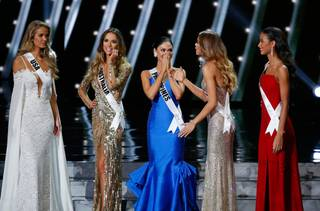 The final five contestants, including Miss Philippines Pia Alonzo Wurtzbach, center, react onstage at the 2015 Miss Universe Pageant on Sunday, Dec. 20, 2015, at Planet Hollywood.