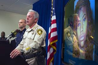 Sheriff Joe Lombardo speaks during a news conference at Las Vegas Metro Police headquarters Monday, Dec. 21, 2015. Lombardo spoke on the fatal auto-pedestrian accident that killed one and injured over 30 people on the Las Vegas Strip Sunday night. A mugshot of suspect Lakeisha Holloway, 24, appears at right.
