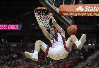 UNLV forward Ben Carter (13) dunks the ball during a game against South Dakota at the Thomas & Mack Center Tuesday, Dec. 22, 2015.