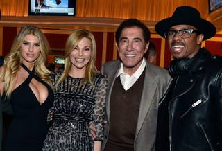 Charlotte McKinney, with Andrea Wynn, Steve Wynn and Nick Cannon, hosts the grand opening of Encore Players Club on Wednesday, Jan. 6, 2016, at Encore.