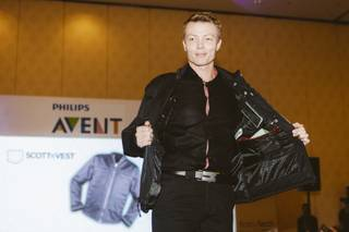 A model walks down the runway at a FashionWare show during CES at the Venetian on Jan. 7, 2016.  He is wearing the SCOTTeVEST, a 30-pocket jacket that can hold up to a full-size laptop.