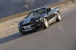 A Shelby GT speeds along the race course at Spring Mountain Motor Resort and Country Club on Saturday, Nov. 7, 2015. Shelby, based in Las Vegas, has begun offering track days in which prospective buyers can test drive the company's vehicles at high speed.