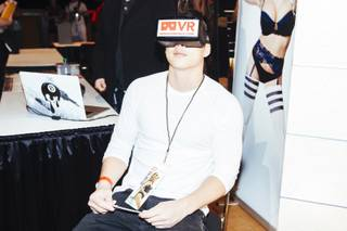 An attendee demonstrates a virtual-reality headset from VRSexperience during the 2016 AVN/Adult Entertainment Expo on Wednesday, Jan. 20, 2016, at the Hard Rock Hotel.