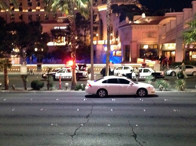 Metro Police officers block Las Vegas Boulevard South at Flamingo Road at the scene of an officer-involved shooting on Friday, Jan. 22, 2016. The boulevard was closed between Flamingo and the Paris resort as officers investigated.