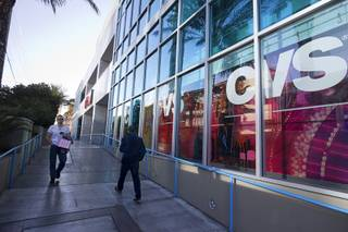 Pedestrians pass by the CVS Pharmacy in Sky Las Vegas tower, 2700 Las Vegas Boulevard South, Thursday, Jan. 28, 2016. The pharmacy has been listed for sale.