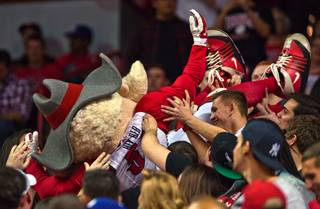 UNLV mascot Hey Reb surfs the crowd while facing San Diego State during their game at the Thomas & Mack Center on Saturday, January 30, 2016.