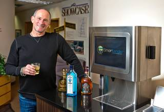 Real estate developer Barry Fieldman with his new venture, the automated cocktail maker called a Smartender, on Tuesday, Feb. 2, 2016.