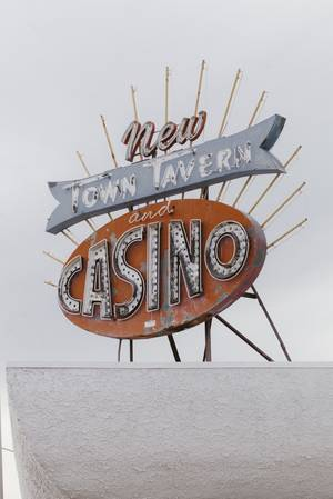 A neon sign signifying the New Town Tavern and Casino, located on F Street and Jackson in the Historic Westside on Jan. 29, 2016.