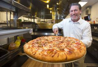 "Bryon Stephens, president and COO of Marco's Pizza, stands in Marco's Pizza at 3400 S. Hualapai Way on Thursday, Feb. 4, 2016. Stephens recently appeared on CBS' ""Undercover Boss."" The franchise has nearly 700 locations in 35 states and plans to open eight more in the Las Vegas Valley, Stephens said."