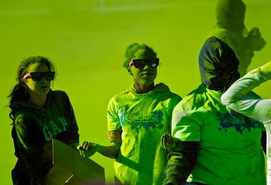 Volunteers are covered with green dust as they toss it on runners at a checkpoint during the Las Vegas Color Vibe 5K run at Craig Ranch Park on Saturday, February 6 2016.  A portion of the proceeds from the event will benefit the Nevada Childhood Cancer Foundation.  L.E. Baskow