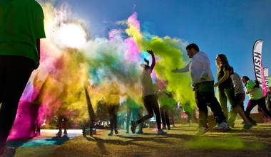 Runners are blasted with more dust as they reach the finish line of the Las Vegas Color Vibe 5K run at Craig Ranch Park on Saturday, February 6 2016.  A portion of the proceeds from the event will benefit the Nevada Childhood Cancer Foundation.  L.E. Baskow