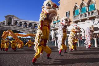 Lion and dragon dancers perform in front of the Venetian during Chinese New Year celebrations at the Venetian and Palazzo Monday, Feb. 8, 2016. The Chinese New Year, the Year of the Monkey, began Monday.