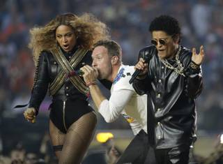 Beyonce, Coldplay singer Chris Martin and Bruno Mars perform during halftime of Super Bowl 50 on Sunday, Feb. 7, 2016, in Santa Clara, Calif.