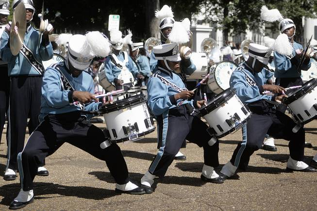 "Members of the Jackson State University marching band's drumline breaks out in a dance routine during a rendition of the song, ""The Show"" by hip-hop artist Doug E. Fresh during the annual homecoming parade, Saturday, Oct. 8, 2011 in Jackson, Miss."