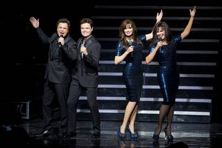 Donny and Marie Osmond flank their Madame Tussauds wax figures as they are unveiled during their headliner show Tuesday, Feb. 9, 2016, at Flamingo Las Vegas. The figures will be permanently on display at Madame Tussauds at the Venetian.