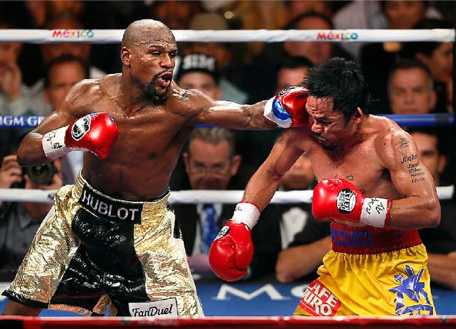 Floyd Mayweather connects to the chin of Manny Pacquiao during their fight at the MGM Grand Garden Arena on Saturday, May 2, 2015.