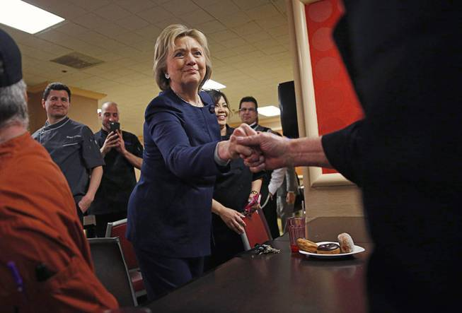 Democratic presidential candidate Hillary Clinton meets with employees of Harrah's on Saturday, Feb. 13, 2016, in Las Vegas.