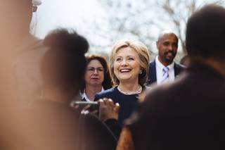 Democratic presidential candidate Hillary Clinton meets with people in front of a beauty school, Saturday, Feb. 13, 2016, in Las Vegas.