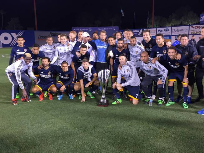The Los Angeles Galaxy pose with the California Clasico Cup after defeating the San Jose Earthquakes, 1-0, in an MLS exhibition match Saturday, Feb. 13, 2016, at Cashman Field.