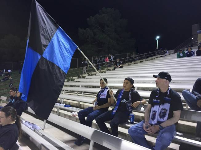 Fans from the San Jose Earthquakes' Ultra fan group hold a flag during halftime of an MLS exhibition match Saturday, Feb. 13, 2016, at Cashman Field.