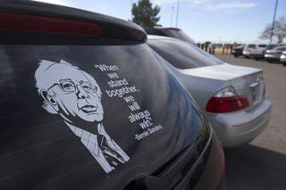 A quote by Democratic presidential candidate Bernie Sanders adorns the rear window of a  car as people line up to attend a Sanders rally at Bonanza High School Sunday, Feb. 14, 2016.