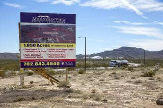 A sign advertises industrial land near Interstate 15 and Highway 93, north of Las Vegas Wednesday, Feb. 17, 2016. Electric car start-up Faraday Future plans to build a $1 billion auto plant in the Apex Industrial Park.