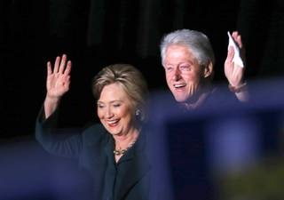 Democratic Presidential candidate Hillary Clinton and former President Bill Clinton arrive for a rally at the Clark County Government Center Friday, Feb. 19, 2016.
