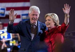 Former President Bill Clinton and Democratic presidential candidate Hillary Clinton wave after Hillary Clinton's victory speech at Caesars Palace Saturday, Feb. 20, 2016.