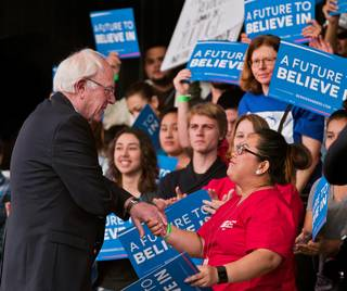 Democratic presidential candidate Bernie Sanders greets a supporter during a caucus watch party and rally at the Henderson Pavilion as the Nevada results come in on Saturday, February 20, 2016.