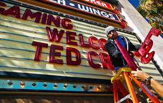 T.J. Vanderford and Nick Kirsch change the letters on the Best Western welcome sign for Republican presidential candidate Ted Cruz making a visit to Pahrump for a rally at the Draft Picks Sports Bar on Sunday, February 21, 2016.