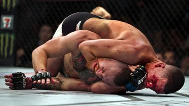 Welterweight Conor McGregor taps out from a choke by opponent Nate Diaz ending their fight during UFC 196 from the MGM Grand Garden Arena.
