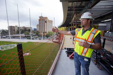 Dominic Crespo, director of construction, gives a tour of Topgolf Las Vegas under construction at Koval Lane and Harmon Avenue on Monday, March 7, 2016. The game is a combination of golf and darts, with players getting points based on how close the balls get to targets on the range. A computer awards the points by reading RFID chips inside the Callaway golf ball.