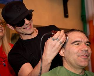 Criss Angel and John Katsilometes take part in the 2016 St. Baldrick's Day fundraiser Saturday, March 5, 2016, at McMullan's Irish Pub.