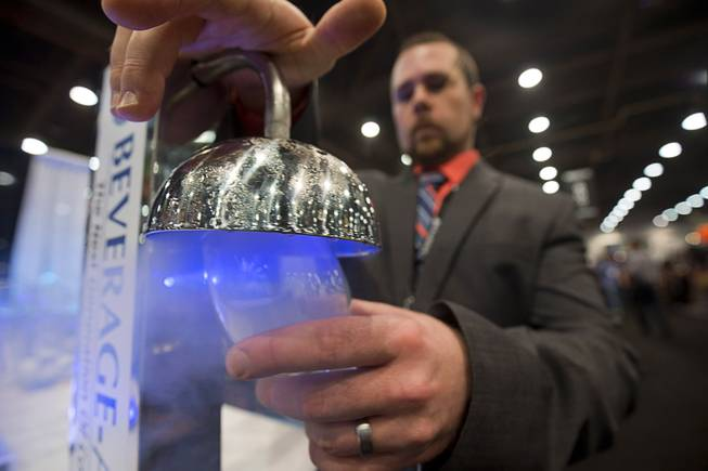 Matt Himes of Beverage Air frosts a glass using Rapid Chill Instant Glass Froster during the 2016 Nightclub & Bar convention at the Las Vegas Convention Center Tuesday, March 8, 2016.