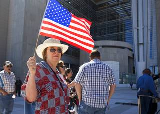 Cathryn Adams and other supporters of Nevada rancher Cliven Bundy gather in front of the U.S. Courthouse in downtown Las Vegas Thursday, March 10, 2016. Bundy is facing charges relating to an armed ranching standoff against Bureau of Land Management agents in April 2014.