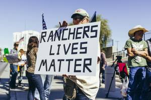 A supporter of Nevada rancher Cliven Bundy holds a sign in front of the U.S. Courthouse in downtown Las Vegas Thursday, March 10, 2016. Bundy is facing charges relating to an armed ranching standoff against Bureau of Land Management agents in April 2014.