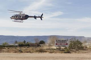 A helicopter prepares to land at Kidwell Airport in Cal-Nev-Ari, Nev. on March 2, 2016.