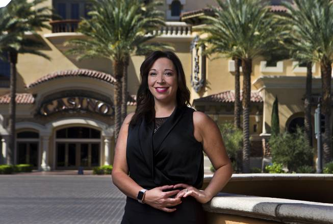Tyra Bell-Holland is the owner of RESORTcierge MD, a medical company that treats customers (primarily tourists) who are staying at resorts/hotels. Bell-Holland stands outside of The District with Green Valley Ranch Resort & Spa  Casino, one of the many places she serves.