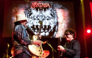 Carlos Santana, left, performs at House of Blues on Monday, March 21, 2016, in Mandalay Bay.