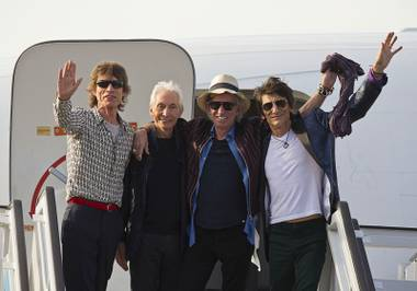 Mick Jagger, Charlie Watts, Keith Richards and Ron Wood of The Rolling Stones stand for photos from a plane that brought them to Cuba at Jose Marti International Airport on Thursday, March 24, 2016, in Havana. The Stones are performing a free concert in Havana on Friday, becoming the most famous act to play Cuba since its 1959 revolution.