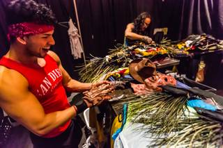 "Cast member Alejandro Granados tries on his Freddy Krueger gloves as stylist and costume Designer Jeffrey Debarathy works during rehearsal for the new Chippendales show ""53X"" at Chateau on Thursday, March 10, 2016, at Paris Las Vegas."