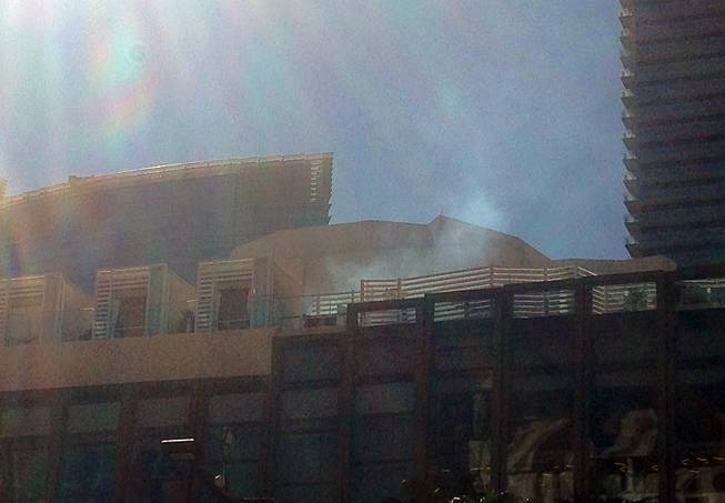 Smoke can be seen from the pool-deck area of the Cosmopolitan on the Strip, Saturday, March 26, 2016.