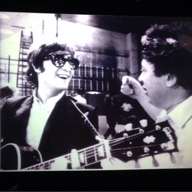 "Marty Allen, right, is shown goofing off with John Lennon before ""The Ed Sullivan Show"" in February 1964."