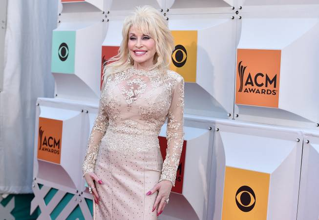 Dolly Parton arrives at the 51st annual Academy of Country ...